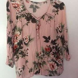 Light pink floral top with lacing in the middle